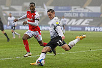 Connor Roberts of Swansea City (R) takes a cross past Florian Jozefzoon of Rotherham (L) during the Sky Bet Championship between Swansea City and Rotherham at the Liberty Stadium, Swansea, Wales, UK. Saturday 21 November 2020