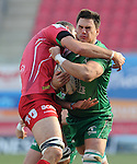 Connacht's Quinn Roux is tackled by Scarlets' Johan Snyman<br /> <br /> Rugby - Scarlets V Connacht - Guinness Pro12 - Sunday 15th Febuary 2015 - Parc-y-Scarlets - Llanelli<br /> <br /> © www.sportingwales.com- PLEASE CREDIT IAN COOK