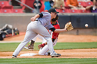 Third baseman Matt Dominguez #33 of the Jacksonville Suns waits for the throw as Kristopher Negron #11 of the Carolina Mudcats slides into third base with a triple at Five County Stadium May 16, 2010, in Zebulon, North Carolina.  Photo by Brian Westerholt /  Seam Images