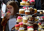 BOSTON, MAY 12:   Rain didn't dampen the spirit of the attendees like Alessia Kirkpatrick, 8, enjoys one of the cupcakes after a service to celebrate the 350th anniversary, Sunday, May 12, 2019, at the old South Church in Boston. Jim Michaud / MediaNews Group/Boston Herald)