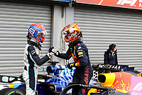 28th August 2021; Spa Francorchamps, Stavelot, Belgium: FIA F1 Grand Prix of Belgium, qualifying sessions;  F1 Grand Prix of Belgium 63 George Russell GBR, Williams Racing takes 2nd on pole and shakes hands with pole winner 33 Max Verstappen NED, Red Bull Racing