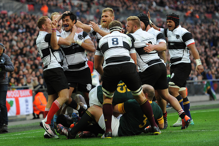 Melani Nanai (Blues) of Barbarians is swamped by team mates after scoring a try during the Killik Cup match between Barbarians and South Africa at Wembley Stadium on Saturday 5th November 2016 (Photo by Rob Munro)