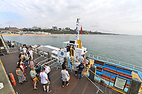 BNPS.co.uk (01202 558833)<br /> Pic: BNPS<br /> <br /> Pictured: Boat day trippers enjoy the warm sunshine<br /> <br /> Weather input - Warm weather in Bournemouth<br /> <br /> People made the most of the late September sun at Bournemouth beach in Dorset today (Sunday).