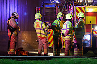 Pictured: Fire service personnel by the damaged building in the Waunceirch area of Neath, Wales, UK. Monday 14 January 2018<br /> Re: Four flats have been evacuated after an explosion in Neath at 8:30pm on Monday.<br /> Extensive damage was caused to Waun Las, in the Waunceirch area and arrangements made to house its residents until the building is deemed safe.<br /> One woman was taken to hospital with serious burn injuries which are not believed to be life threatening.<br /> A joint investigation is under way between South Wales Police and the fire service to determine the cause.<br /> Wales and West Utilities said the gas supply to the affected property had been isolated.