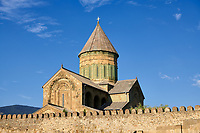 Pictures & images of the exterior and wall around the Eastern Orthodox Georgian Svetitskhoveli Cathedral (Cathedral of the Living Pillar) , Mtskheta, Georgia (country). A UNESCO World Heritage Site.<br /> <br /> Currently the second largest church building in Georgia, Svetitskhoveli Cathedral is a masterpiece of Early Medieval architecture completed in 1029 by Georgian architect Arsukisdze on an earlier site dating back toi the 4th century.