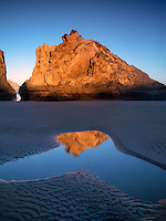 Low tide pools reflecting seastack at sunrise. Bandon Beach. Oregon