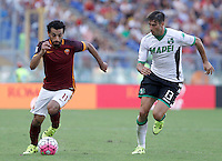 Calcio, Serie A: Roma vs Sassuolo. Roma, stadio Olimpico, 20 settembre 2015.<br /> Roma's Mohamed Salah, left, is chased by Sassuolo's Federico Peluso during the Italian Serie A football match between Roma and Sassuolo at Rome's Olympic stadium, 20 September 2015.<br /> UPDATE IMAGES PRESS/Isabella Bonotto