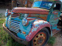 An old truck sits in a field in Taos, New Mexico