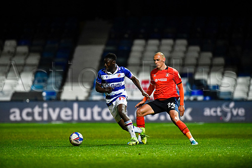 21st April 2021; Kenilworth Road, Luton, Bedfordshire, England; English Football League Championship Football, Luton Town versus Reading; Andy Yiadom of Reading breaks away from the challenge of Kal Naismith of Luton Town.