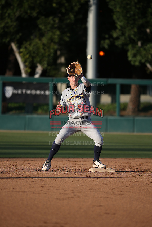 Robbie Tenerowicz (1) of the California Bears during infield practice before a game against the Southern California Trojans at Dedeaux Field on March 18, 2016 in Los Angeles, California. California defeated Southern California, 5-4. (Larry Goren/Four Seam Images)