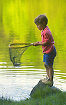 Boy in R.B. Winter State Park with fishing net on lake.