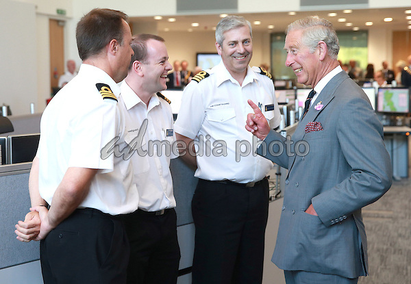 01 July 2015 - London, England - Prince Charles, Prince of Wales shares a joke with Steve Carson (R) National Maritime Operations Commander and Richard Cockerill (L) at the National Maritime Operations Centre in Fareham, Hampshire.  The Prince officially opened the building which is the UK's flagship centre within the network, supported by ten coastguard operations centres across the country it manages up-to-the-minute nationwide search and rescue capabilities. Photo Credit: Alpha Press/AdMedia