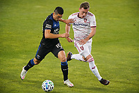 SAN JOSE, CA - OCTOBER 28: Cristian Espinoza #10 of the San Jose Earthquakes is marked by Corey Baird #10 of Real Salt Lake during a game between Real Salt Lake and San Jose Earthquakes at Earthquakes Stadium on October 28, 2020 in San Jose, California.