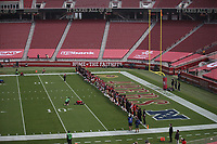 SANTA CLARA, CA - SEPTEMBER 13:  The San Francisco 49ers stand together during a presentation on social justice before their game against the Arizona Cardinals at Levi's Stadium on Sunday, September 13, 2020 in Santa Clara, California. (Photo by Michael Zagaris)