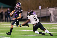 Bladen Fike (5) of Fayetteville avoids pressure from Cedric Small (8) of  Little Rock Central at Harmon Stadium, Fayetteville, Arkansas on Friday, November 13, 2020 / Special to NWA Democrat-Gazette/ David Beach