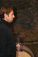 Philippe Viret in front of a barrel in profile.  Domaine Viret, Saint Maurice sur Eygues, Drôme Drome France, Europe