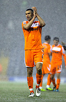 Pictured: Steven Caulker of Swansea thanking supporters after the final whistle. Saturday, 04 February 2012<br /> Re: Premier League football, West Bromwich Albion v Swansea City FC v at the Hawthorns Stadium, Birmingham, West Midlands.