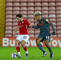 21st November 2020, Oakwell Stadium, Barnsley, Yorkshire, England; English Football League Championship Football, Barnsley FC versus Nottingham Forest; Matthew James of Barnsley shields the ball from Lyle Taylor of Nottingham Forrest