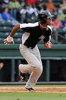 Outfielder Nick Williams (1) of the Hickory Crawdads in a game against the Greenville Drive on Sunday, June 9, 2013, at Fluor Field at the West End in Greenville, South Carolina. Williams is the No. 25 prospect of the Texas Rangers, according to Baseball America and was a second-round pick in the 2012 First-Year Player Draft. Hickory won, 6-3. (Tom Priddy/Four Seam Images)