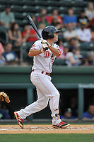 Second baseman Chad De La Guerra (20) of the Greenville Drive bats in a game against the Columbia Fireflies on Thursday, April 21, 2016, at Fluor Field at the West End in Greenville, South Carolina. Columbia won, 13-9. (Tom Priddy/Four Seam Images)