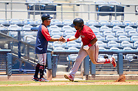 FCL Twins manager Takashi Miyoshi congratulates LaRon Smith (25) as he rounds the bases after hitting a home run during a game against the FCL Rays on July 20, 2021 at Charlotte Sports Park in Port Charlotte, Florida.  (Mike Janes/Four Seam Images)