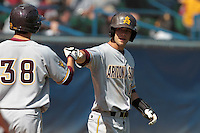 Joey DeMichele #18 of the Arizona State Sun Devils is greeted after scoring against the Long Beach State Dirtbags at Blair Field on March 11, 2012 in Long Beach,California. Arizona State defeated Long Beach State 6-1.(Larry Goren/Four Seam Images)