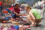 Young tourist shops for native handicrafts at a market in Antigua, Guatemala