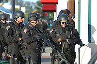 05-31-08: Pacific Beach, San Diego, CA.  A SWAT officer prepares to throw a flash grenade into a house in Pacific Beach where suspect WalterCordell (52) is hiding.  Cordell beat his girlfriend Marlene Pernicano severly with a hammer the day before.