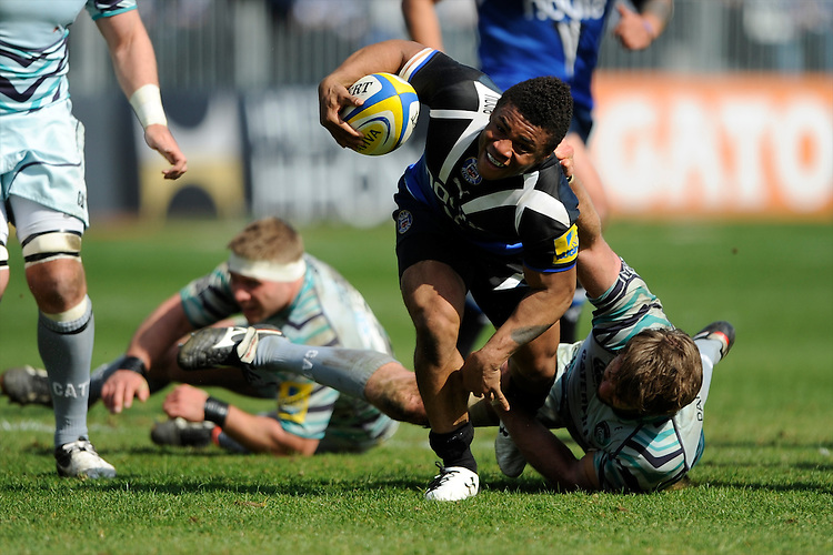 Kyle Eastmond of Bath Rugby is tackled by Geoff Parling of Leicester Tigers during the Aviva Premiership match between Bath Rugby and Leicester Tigers at The Recreation Ground on Saturday 20th April 2013 (Photo by Rob Munro)