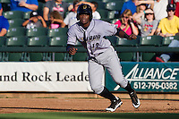 Omaha Storm Chasers third baseman Irving Falu #12 leads off of first base during the first inning of the Pacific Coast League baseball game against the Round Rock Express on July 20, 2012 at the Dell Diamond in Round Rock, Texas. The Chasers defeated the Express 10-4. (Andrew Woolley/Four Seam Images).