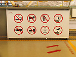 Prohibition signs and symbols in a subway station.