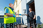 Post man Michael O'Callaghan delivering Kerry's Eye to Ann O'Mahony in Mitchels road Tralee.