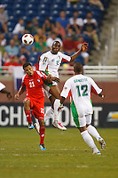 Guadeloupe forward Richard Socrier (21) heads the ball over Panama midfielder Amilcar Henríquez (21) during the CONCACAF soccer match between Panama and Guadeloupe at Ford Field Detroit, Michigan.