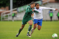 Shannon Boxx (green) holds off Chioma Igwe...Saint Louis Athletica and Boston Breakers played to a 1-1 tie at Anheuser-Busch Soccer Park, Fenton, Missouri.