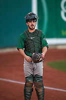 Beloit Snappers catcher John Jones (32) warms up in the bullpen during a Midwest League game against the Lansing Lugnuts at Cooley Law School Stadium on May 4, 2019 in Lansing, Michigan. Beloit defeated Lansing 2-1. (Zachary Lucy/Four Seam Images)