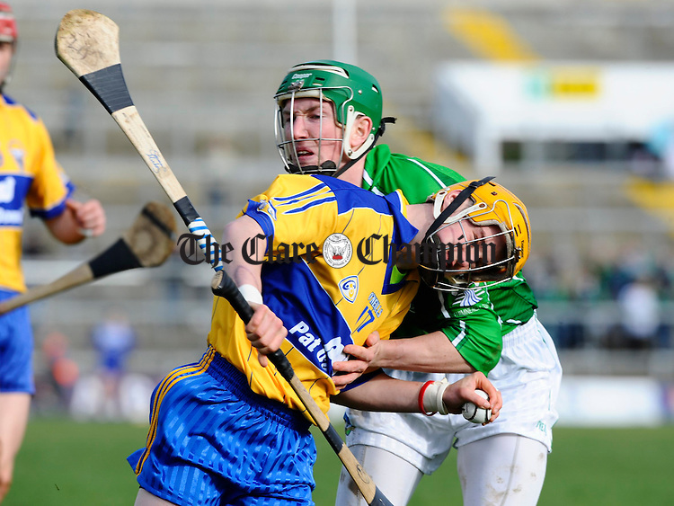 Clare's Ger Arthur tries to burst past Limerick's Seamus Hickey during their National League game in Limerick. Photograph by John Kelly.