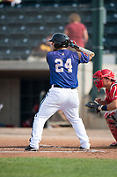 Missoula Osprey third baseman Buddy Kennedy (24) at bat in front of catcher Griffin Barnes (28) during a Pioneer League game against the Orem Owlz at Ogren Park Allegiance Field on August 19, 2018 in Missoula, Montana. The Missoula Osprey defeated the Orem Owlz by a score of 8-0. (Zachary Lucy/Four Seam Images)