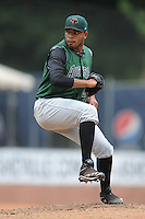 Augusta GreenJackets starting pitcher Edwin Escobar #22 delivers a pitch during a game against the Asheville Tourists at McCormick Field Field on July 8, 2012 in Asheville, North Carolina. The Tourists defeated the GreenJackets 3-2. (Tony Farlow/Four Seam Images).