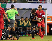 CHICAGO, IL - JULY 7: Weston Mckennie #8 holds the ball from Jonathan Dos Santos #6 after a foul during a game between Mexico and USMNT at Soldiers Field on July 7, 2019 in Chicago, Illinois.