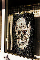 Our Halloween Skull poster arrived today and is on display in the window by our front door.  Buy your own poster for $9.96:   http://www.magcloud.com/browse/issue/483299?__r=188003