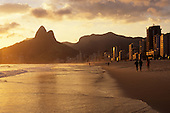 Rio de Janeiro, Brazil. Dois Irmaos (Two Brothers) mountain in the evening light and Leblon Ipanema beach; sea and sand.