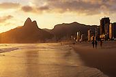 Rio de Janeiro, Brazil. Dois Irmaos (Two Brothers) mountain in the evening light and Leblon Ipanema beach; sea and sand.