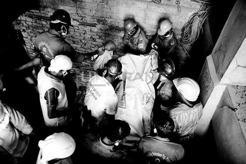 Rescuers carry the body of a victim of Rana Plaza building collapse at Savar, near Dhaka, Bangladesh.