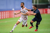 LAKE BUENA VISTA, FL - JULY 22: Justin Meram #9 of Real Salt Lake and Luis Martins #36 of Sporting Kansas City battle for the ball during a game between Real Salt Lake and Sporting Kansas City at Wide World of Sports on July 22, 2020 in Lake Buena Vista, Florida.