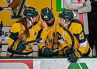 8 February 2020: University of Vermont Catamounts Allie Granato (left), Anna Erickson (center) and Sara Levesque (right) smile on the bench after celebrating a third period goal against the University of Connecticut Huskies at Gutterson Fieldhouse in Burlington, Vermont. The Huskies defeated the Lady Cats 4-2 in the first game of their weekend Hockey East series. Mandatory Credit: Ed Wolfstein Photo *** RAW (NEF) Image File Available ***