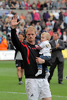 Pictured: Alan Tate of Swansea with his young son, thanking suporters after the end of the game. Saturday 07 May 2011<br /> Re: Swansea City FC v Sheffield United, npower Championship at the Liberty Stadium, Swansea, south Wales.