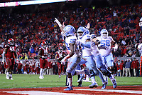 RALEIGH, NC - NOVEMBER 30: Javonte Williams #25 of the University of North Carolina celebrates scoring his first touchdown with Dazz Newsome #5 during a game between North Carolina and North Carolina State at Carter-Finley Stadium on November 30, 2019 in Raleigh, North Carolina.
