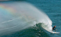 O.windsurf.1005.jl.jpg/photo Jamie Scott Lytle/Marcus Barker of Laguna Niguel surfs a nice wave where the Santa Anna winds spray the top of the wave back causing a rainbow effect. Wednsday morning just north of the Oceanside Pier. (More info about the weather here)