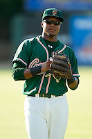 Yordy Cabrera (25) of the Greensboro Grasshoppers warms up in the outfield prior to the game against the Kannapolis Intimidators at CMC-Northeast Stadium on July 15, 2013 in Kannapolis, North Carolina.  The Intimidators defeated the Grasshoppers 4-0.   (Brian Westerholt/Four Seam Images)