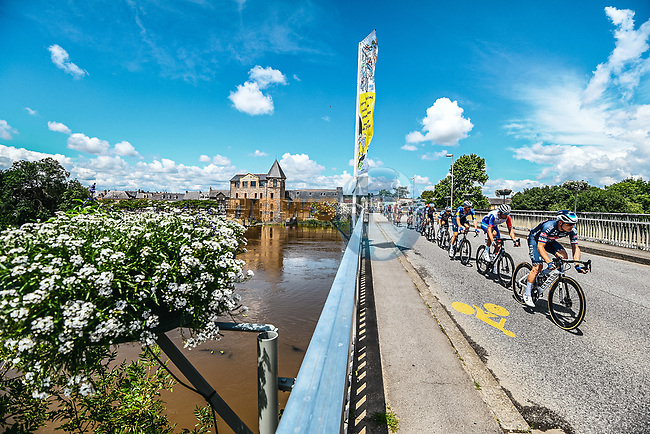 The peloton pass by La minoterie de Guipry-Messac during Stage 4 of the 2021 Tour de France, running 150.4km from Redon to Fougeres, France. 29th June 2021.  <br /> Picture: A.S.O./Charly Lopez | Cyclefile<br /> <br /> All photos usage must carry mandatory copyright credit (© Cyclefile | A.S.O./Charly Lopez)
